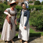 Amy Burrows (right) as Charlotte Brereton