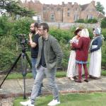 Steve Dorrington directs, Tristan Syrett shoots as Sophie Brown checks make-up.